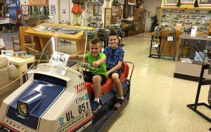 Kids sitting on Evinrude Skeeter snowmobile