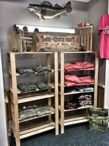 Shelves of tshirts in the Minnesota Fishing Museum gift shop
