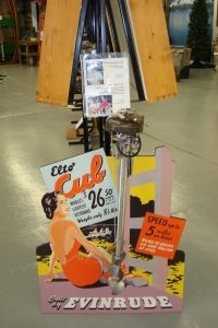 "Vintage motor and advertisement ""Built by Evinrude. Elto Cub. World's Lightest Outboard. $26.50"""
