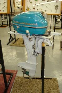 Blue and White Scott Atwater outboard motor on display in museum