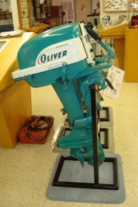 Teal colored Oliver outboard motor