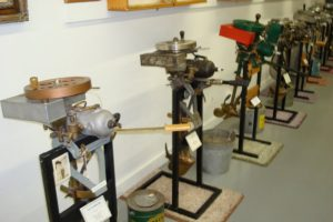 Vintage outboard motors in a row on display