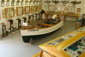 Boat with outboard motor on display in museum