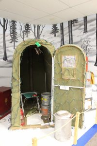 one person ice fishing tent display on fake snow