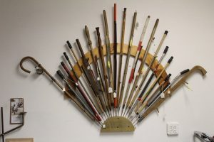 Display of vintage and newer fishing spears