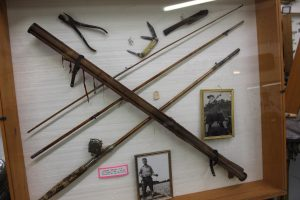 Vintage fishing rod, photos, and knives shown in the Minnesota Fishing Museum