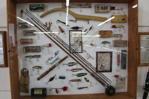 Display case showing vintage lures