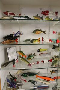 Case of wooden fishing decoys